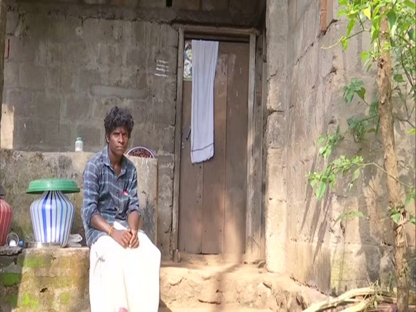 A man sits outside his residence in the tribal village of Avanipara in Kerala. (Photo/ANI)