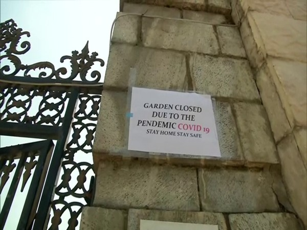 """A notice posted on the gate of a garden read, """"Garden closed due to the pandemic COVID-19, stay home and stay safe. (Photo/ANI)"""