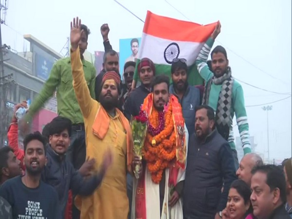 Mountaineer Nitish Singh welcomed by his friends and family with full zeal and zest. (Photo/ANI)