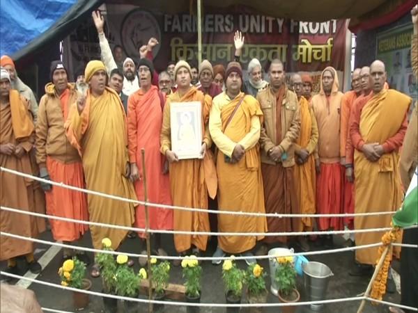 A group of Buddhist monks at the Gazipur (Delhi-UP) border. (Photo/ANI)