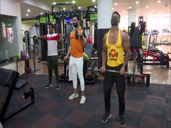 Members working out at a gym in Bhubaneswar. (Photo/ANI)