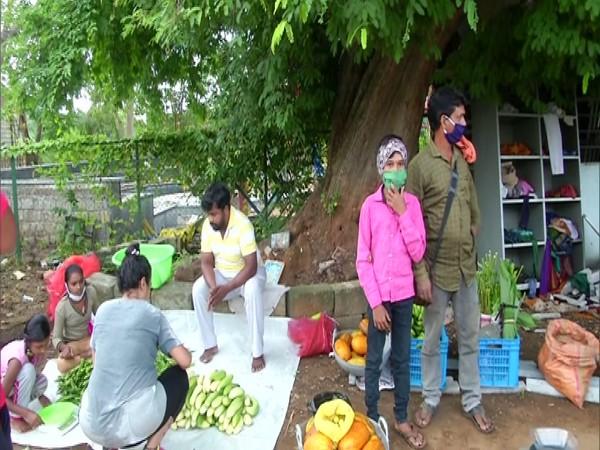 Locals flock to the organic farmers'market in Shivamogga. Photo/ANI