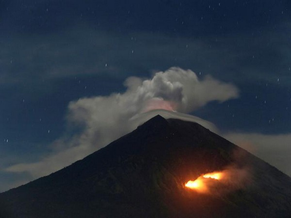 Fire is seen on the slopes of Mount Agung volcano following an eruption on Friday