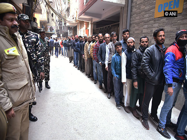 Voters in queue to cast their votes in Delhi on Saturday.