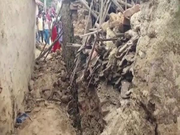 Wall of a 'kuccha' house collapsed in Tilwari village of Banka district in Bihar on Sunday. Photo/ANI