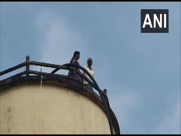 Elderly couple climbed atop a water tank in Harishchandrapuram village in Krishna district in Andhra Pradesh on Friday