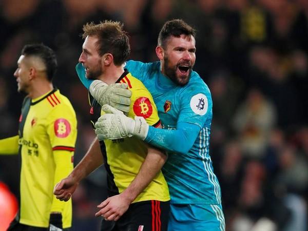 Watford's Ben Foster celebrates after the match with Craig Dawson.