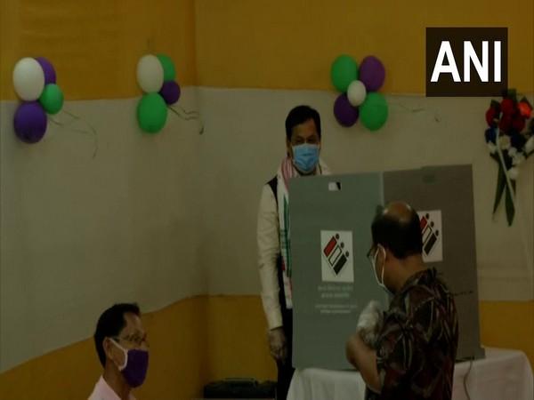 Assam CM Sarbananda Sonowal casts his vote a polling centre in Dibrugarh (Photo/ ANI)
