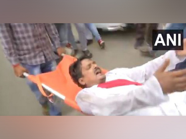 RJD MLA Satish Kumar was carried on a stretcher from Bihar Assembly. (Photo/ANI)