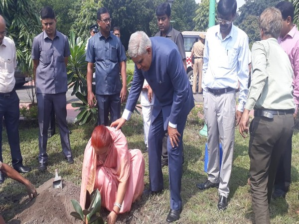 West Bengal Governor Jagdeep Dhankhar along with the First Lady during the planting of saplings in his garden on Wednesday. Photo/ANI