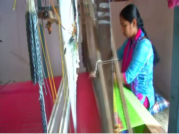 A lady weaving a cloth at a handloom in Coimbatore [Photo/ANI]