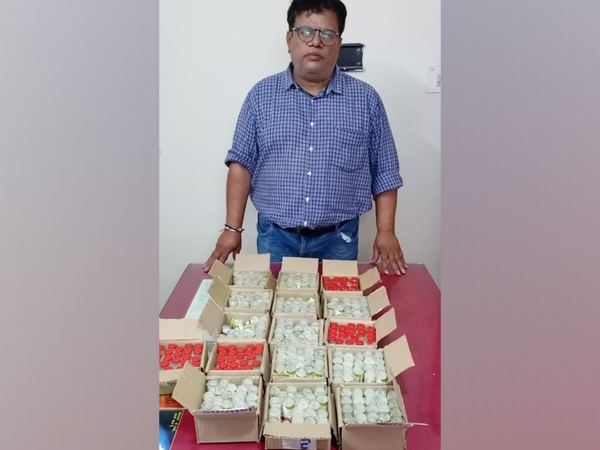 The arrested man with the seized batch of counterfeit Remedisivir drugs. (ANI)