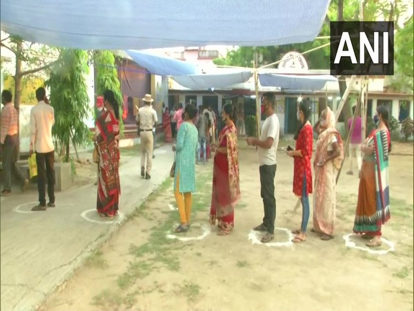 Voters queue up outside a polling booth in Shantiniketan. (Photo/ANI)
