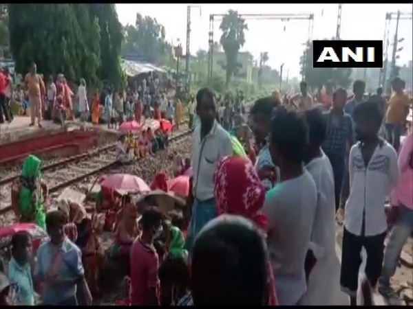 Passengers demanding to board trains operating for essential purposes block railway track in Pandua, West Bengal. (Photo/ANI)