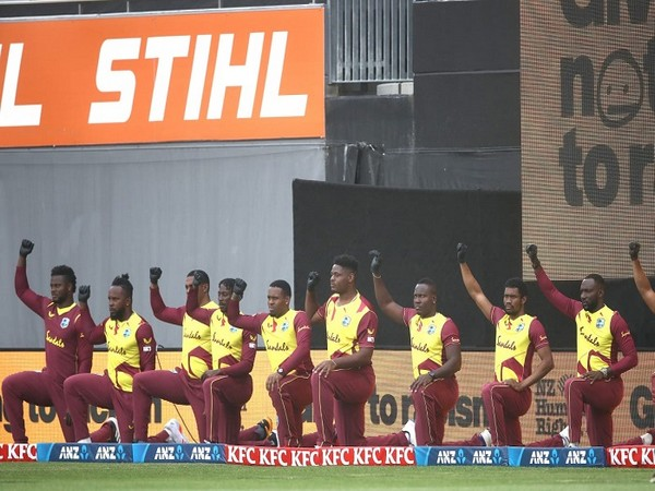 West Indies players take a knee ahead of the game (Image: Windies Cricket's Twitter)