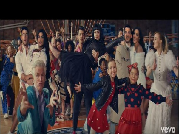 A still from the official music video of 'What A Man Gotta Do',