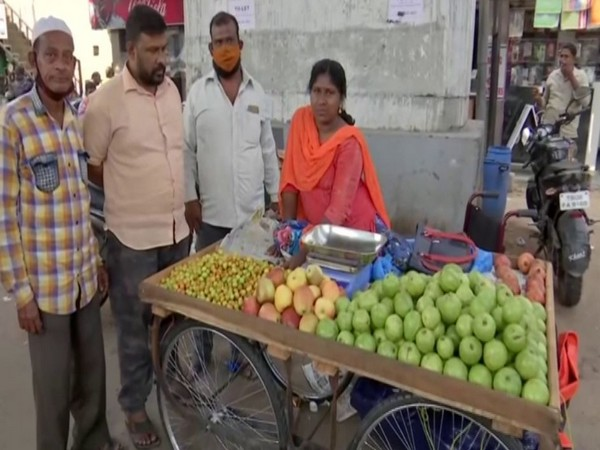 Rama Devi, a differently-abled woman, has changed her life from begging on roads for two years to set up her own fruits trolley. [Photo/ANI]