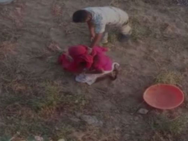 A grab of the video in which a man is beating up a woman in Barmer [Photo/ANI]