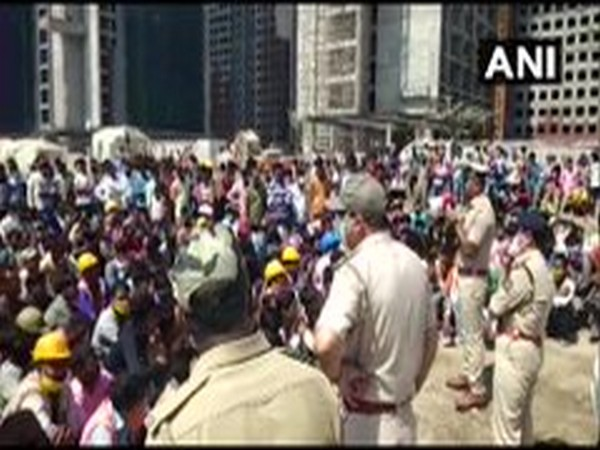 Workers protest at the office of Diamond Bourse on Tuesday. Photo/ANI