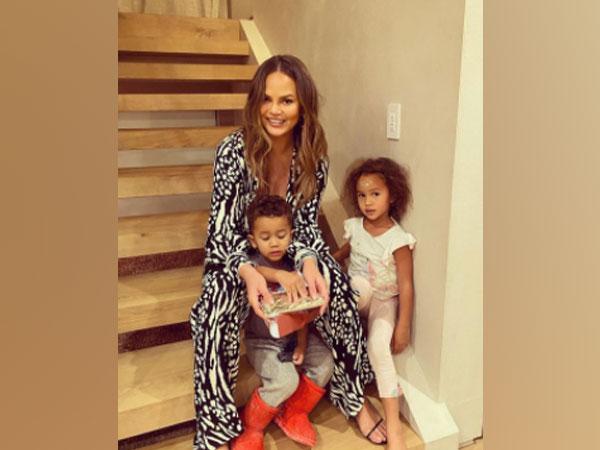 Chrissy Tiegen with her children (Image Source: Instagram)