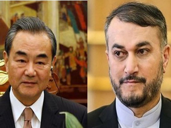 Chinese Foreign Minister Wang Yi and Iranian Foreign Minister Hossein Amir Abdollahian.