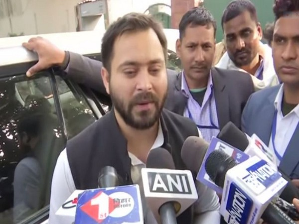 RJD leader Tejashwi Yadav talking to media persons in Patna on Tuesday (photo/ANI)