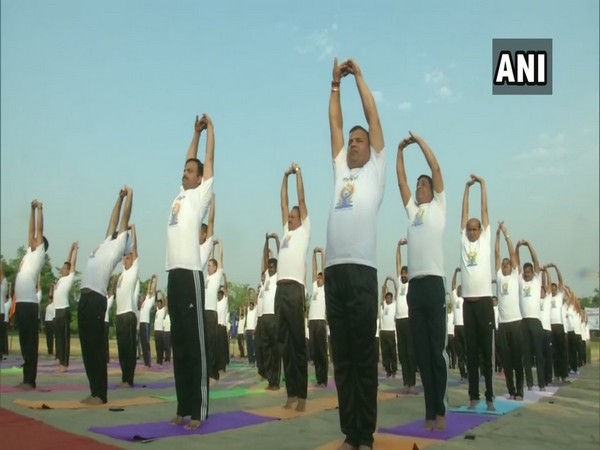 BSF personnel near the International Border in RS Pura while performing Yoga on Thursday. (Photo: ANI)