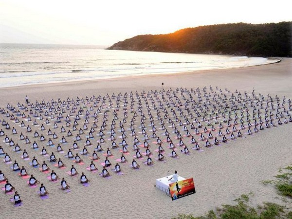 Indian Navy performs Yoga at Kamat beach, Karnataka (Photo/ANI)