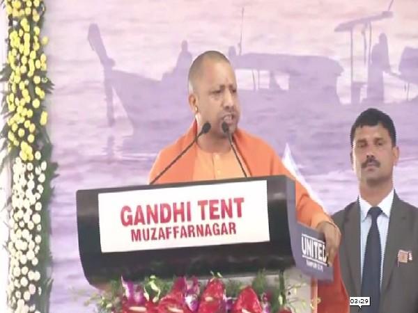 Uttar Pradesh Chief Minister Yogi Adityanath speaking at the event in Bijnor on Monday.