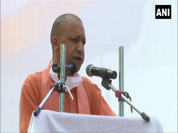 UP Chief Minister Yogi Adityanath addressing an event in Varanasi on Sunday. (Photo/ANI)