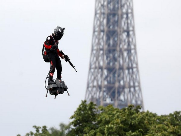 French inventor Frank Zapata on his turbine engine-powered hoverboard at the Champs Elysees in Paris for Bastille Day celebrations on Sunday (Photo/Reuters)