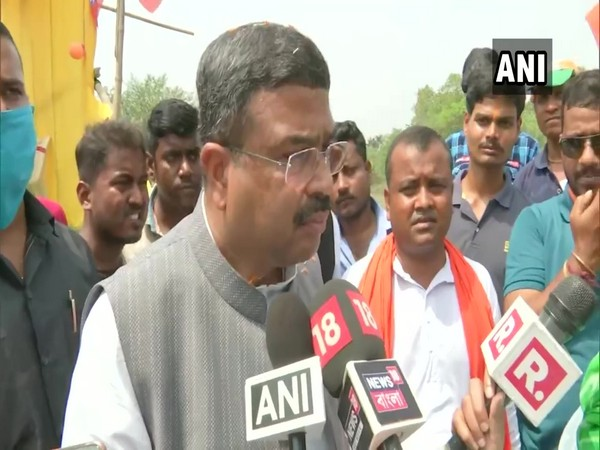 Union Minister Dharmendra Pradhan speaking to reporters on Thursday.